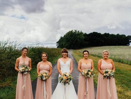Soft peach wedding blooms for Swallows Nest Barn