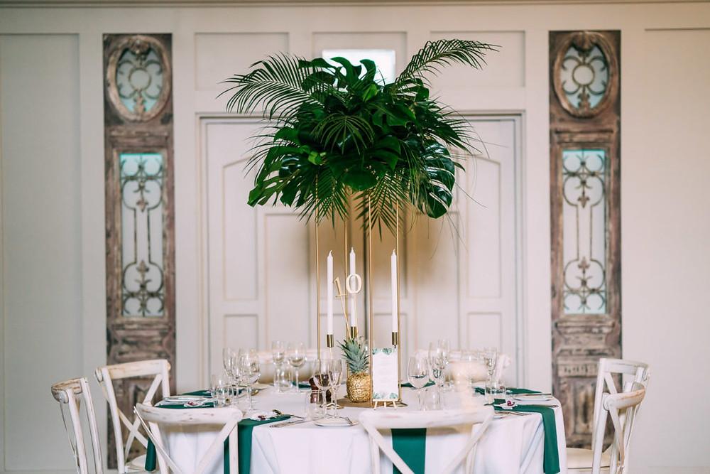 Tropical foliage table arrangement