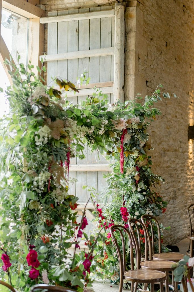 Autumn floral arch for wedding ceremony