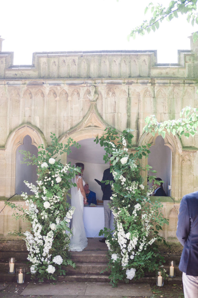 Natural wedding floral ceremony arch