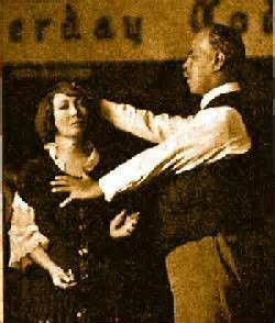 Smith Wigglesworth, an evangelist during the late 1800's - 1942, praying for a woman.