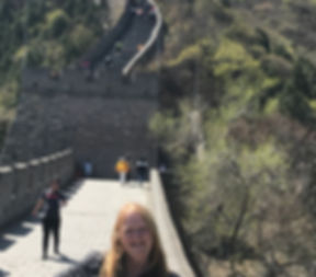 Kim Pemberton in China standing by the Great Wall.