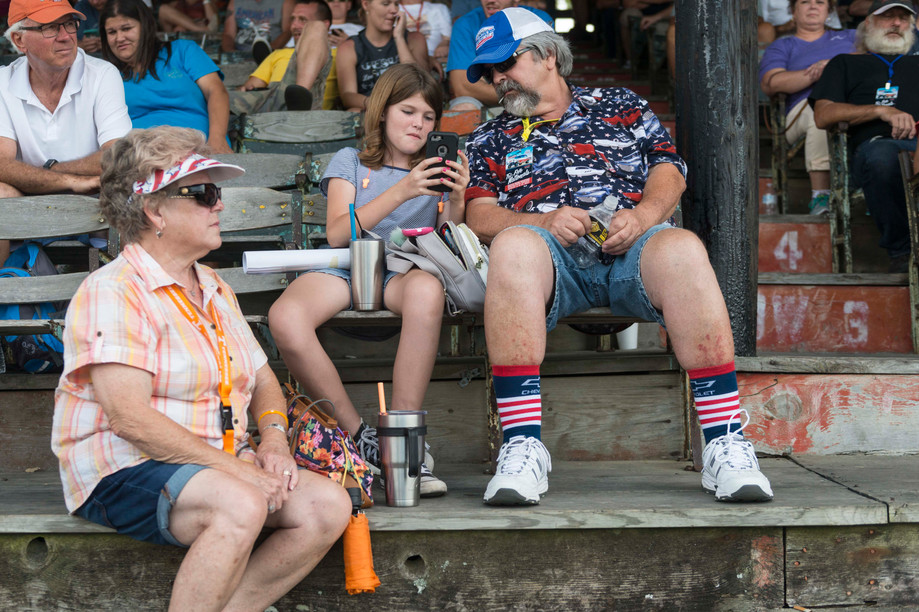 Judy and Wayne Miller sit with their granddaughter, Emma Sears, of Loganville, Georgia waiting for the next drag race during the Tri-Five Nationals on Saturday at Beech Bend Raceway. Owners and fans of 1955-1957 Chevrolets from around the country came out to Beech Bend Raceway for the third annual Tri-Five Nationals on Sat. Aug.12, 2017.
