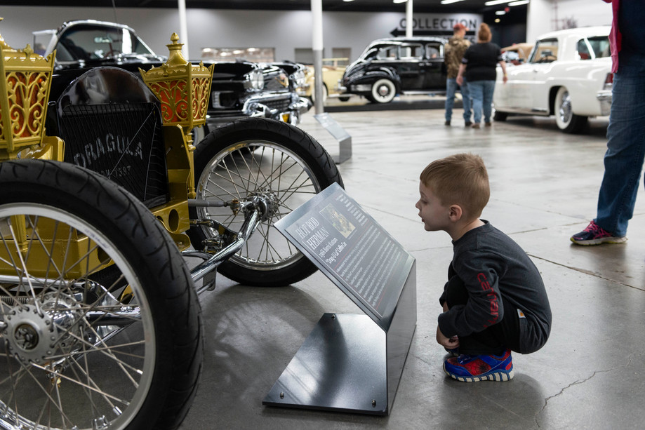 """Waylon Sterrett, 3, of Paxico checks out a 1966 Barris Kustom """"Drag-U-La"""" Coffin Car during the grand opening of the Midwest Dream Car Collection on Saturday in Manhattan, Kansas. The replica car was made famous on the TV show the """"Munsters"""". It is often referred to as Hot Rod Herman. The collection is the vision of Ward and Brenda Morgan focusing on roadsters, muscle cars, and exotic cars from across the country."""