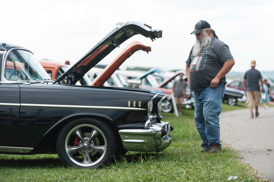Tiger Whiteside, of Sorento, Illinois, checks out a black 1957 Chevrolet Bel Air during the Tri-Five Nationals on Saturday at Beech Bend Raceway. Owners and fans of 1955-1957 Chevrolets from around the country came out to Beech Bend Raceway for the third annual Tri-Five Nationals on Sat. Aug.12, 2017.