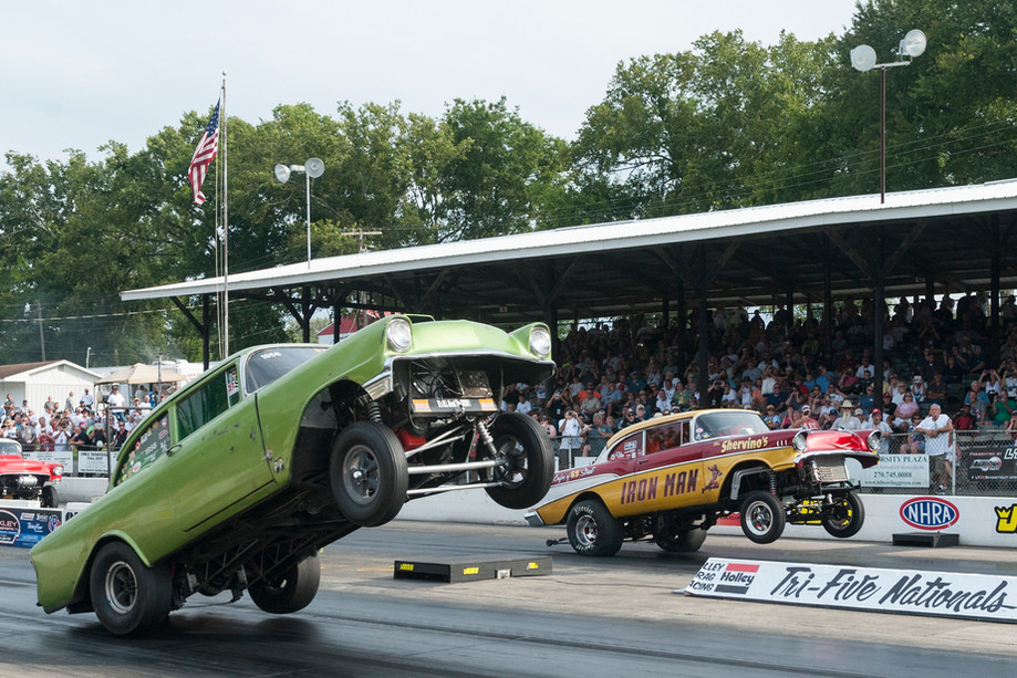 The exhibition class drag races feature wheelie standing cars during the Tri-Five Nationals on Saturday at Beech Bend Raceway. Owners and fans of 1955-1957 Chevrolets from around the country came out to Beech Bend Raceway for the third annual Tri-Five Nationals on Sat. Aug.12, 2017.
