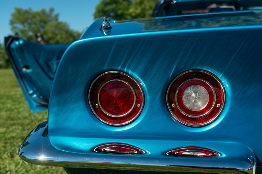 The rear bumper and taillights of a 1969 Chevy Corvette shine in the sun on the lawn at the MATC car show on Saturday in Manhattan, Kansas. The car belongs to Mike Sanson of Clay Center. The Manhattan Area Technical College hosts it's third annual car show and fall celebration to bring attention to it's automotive technology collision programs. Upwards of 50 cars were on display.
