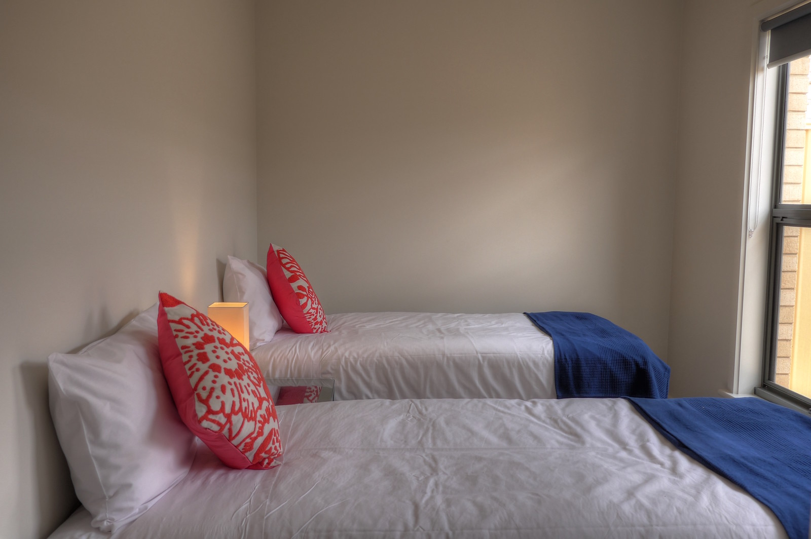 twin beds - red cushions