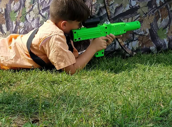 kid on ground green tagger.jpg