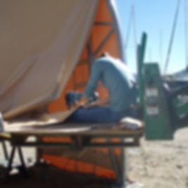 Jenn in the air repairing onsite at Frisco Bay Marina