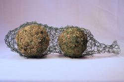 Mitchell-Caught-4_x_14_x_5″,_wool,_lichen,_wire;_handfelted,_crocheted._2012.jpg