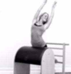 Arabesque stretch on the Pilates Ladder Barrel / High Barrel