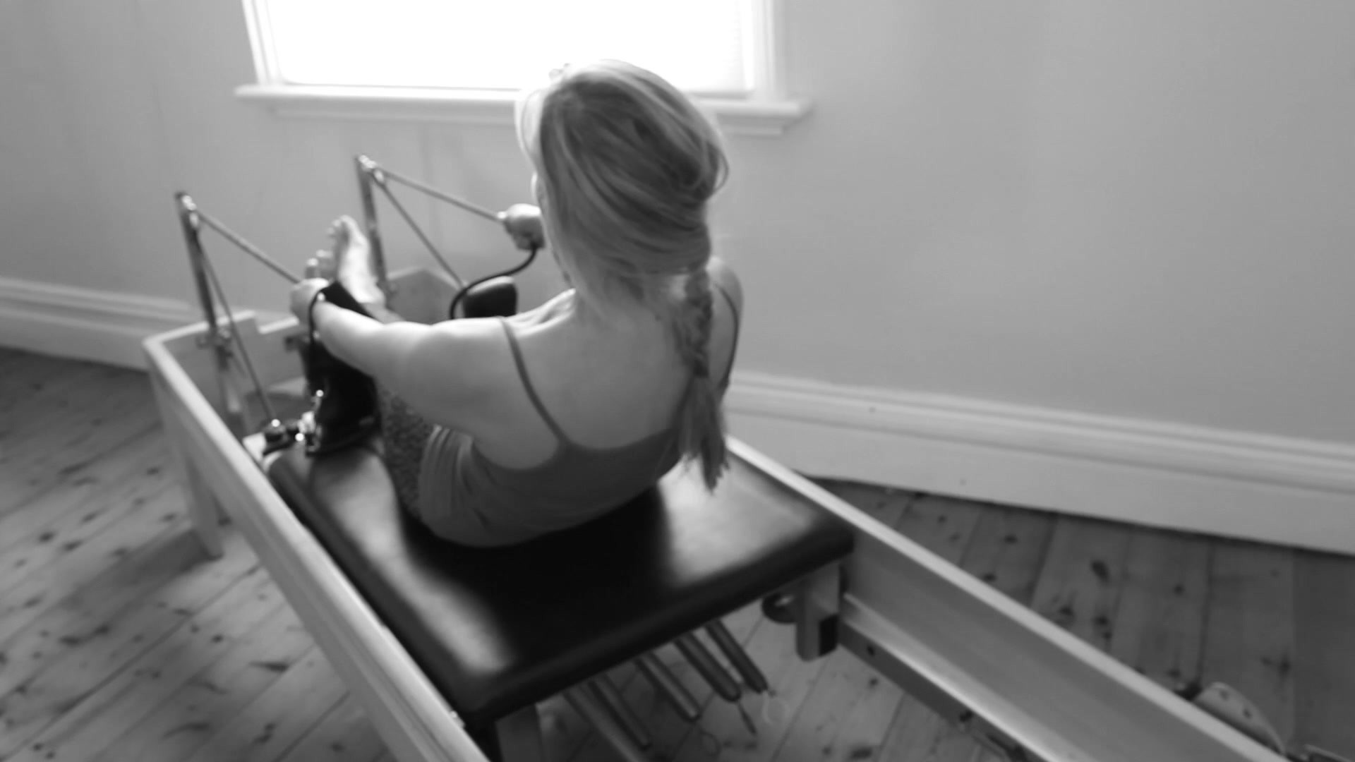 roll down into extension on the Reformer