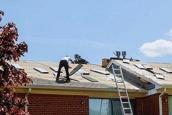 home-roof-construction-applying-roof-new-shingles--2UEEZLK_edited_edited.jpg