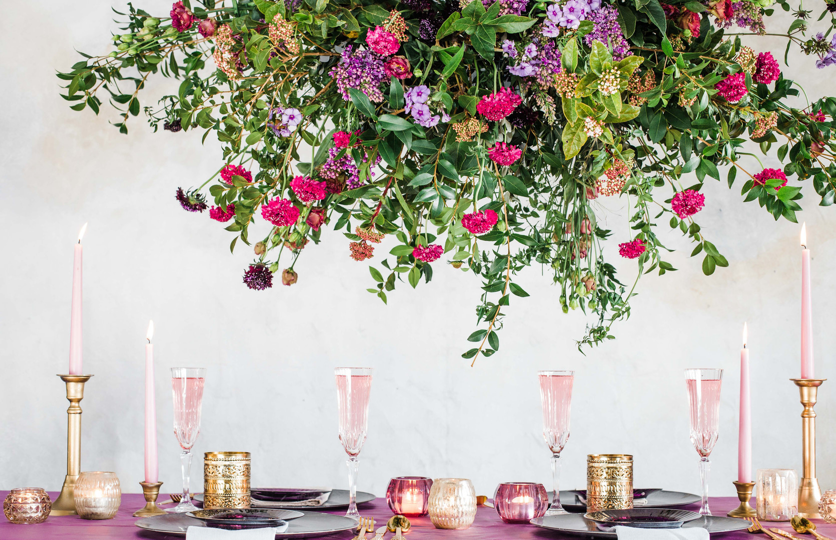 A large hanging floral design in vibrant pinks and purples