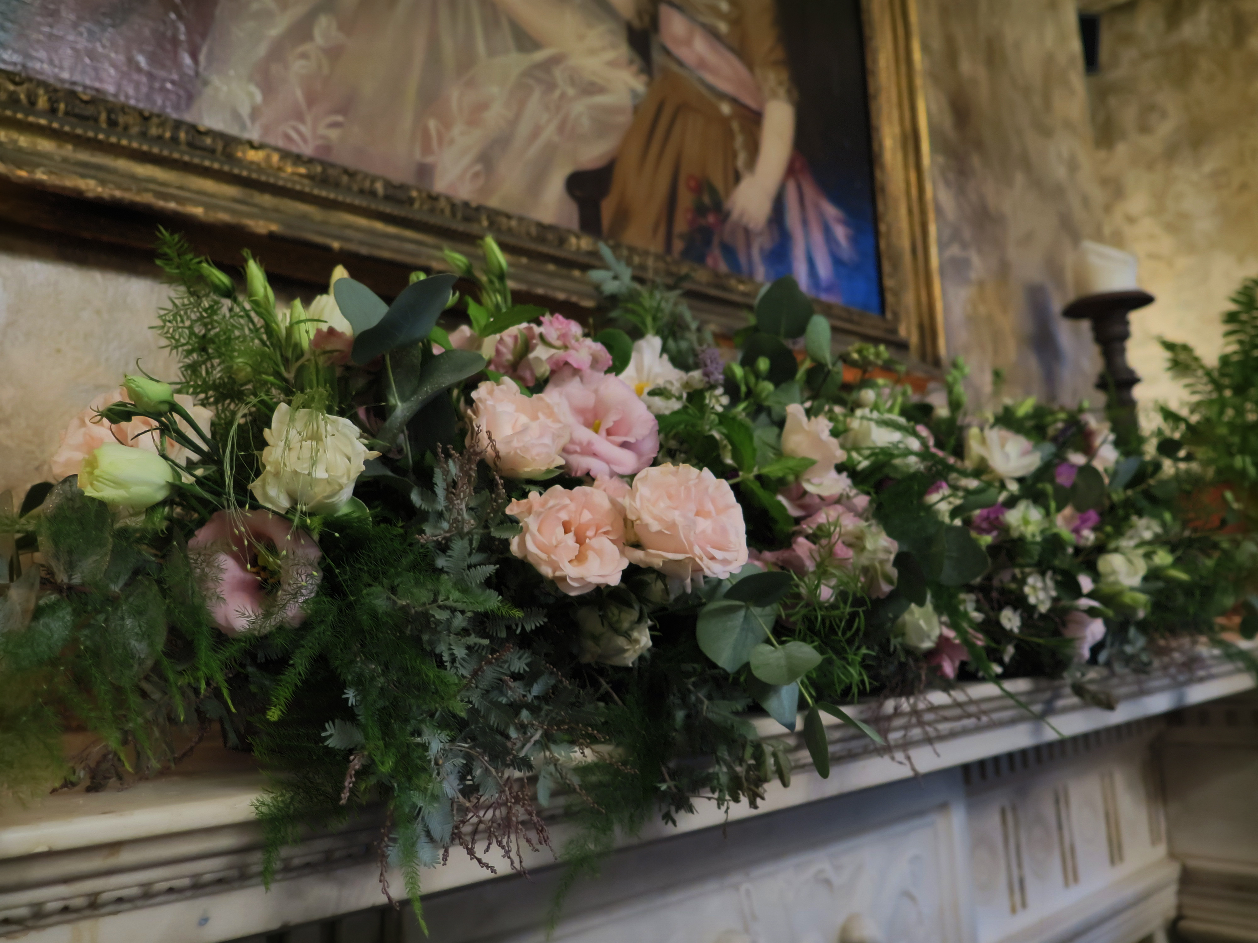 Mantlepiece floral wedding arrangmen
