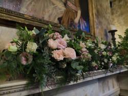 Mantlepiece floral wedding arrangmen