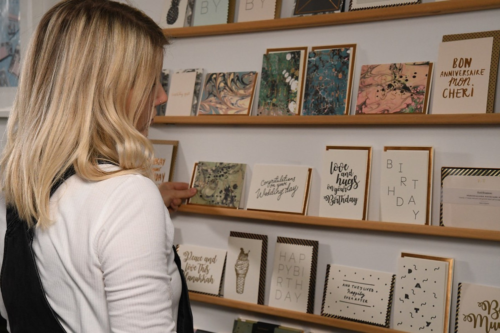 Katie Leamon, luxury stationery designer looks onto her collection of bespoke greeting card designs