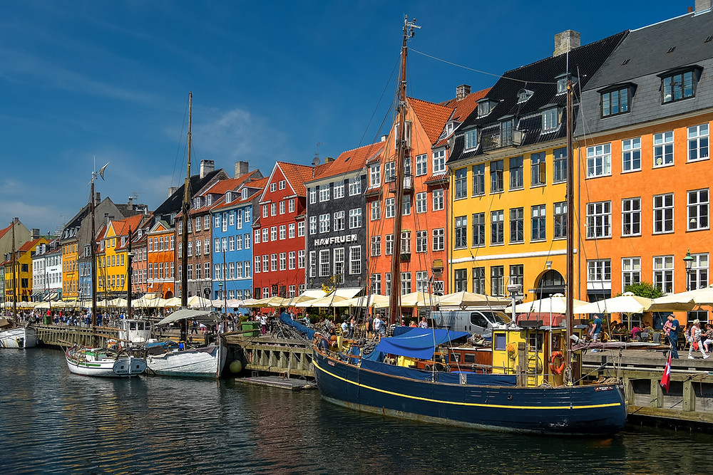 Colourful houses in Copenhagen line the canal