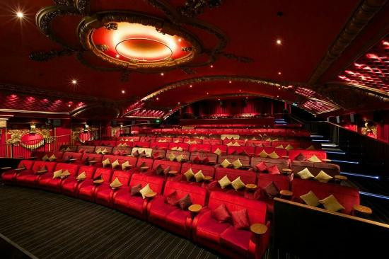 The inside of Everyman Cinema on White Ladies road has luxurious large red seating and 1920s decor