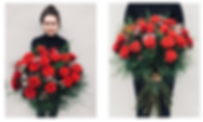 Senior Florist, Ivy of wild about flowers holds a large bouquet of red roses