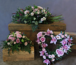 A group of sympathy floral designs
