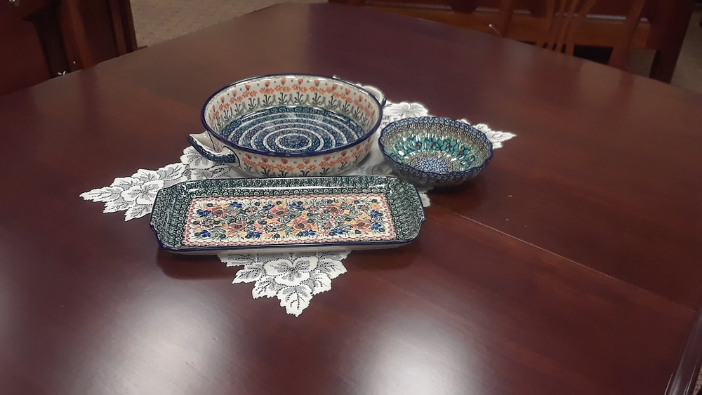"""Short Serving Tray - Green Maroon Unikat (U930) Pattern Scalloped Bowl 6.25"""" - Green Deco Unikat (U3) Pattern Large Round Baker with Handles - Peach Spring Daisy Pattern  Displayed on our Providence Pedestal Dining Table, built in solid cherry with Acres stain"""