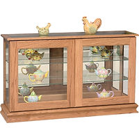 Large Console Curio with Sliding Doors | Glass top, 2 adjustable shelves with plate groove, mirror back, clear glass, no light | Oak in Seely OCS104 | 50in W x 13 1/4in D x 30in H | The Amish Home | Amish Furniture at the Pittsburgh Mills