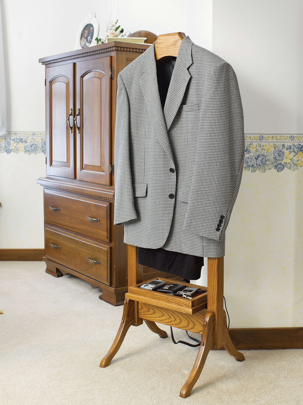 The Suit Valet by Country Corner with power strip is shown in oak
