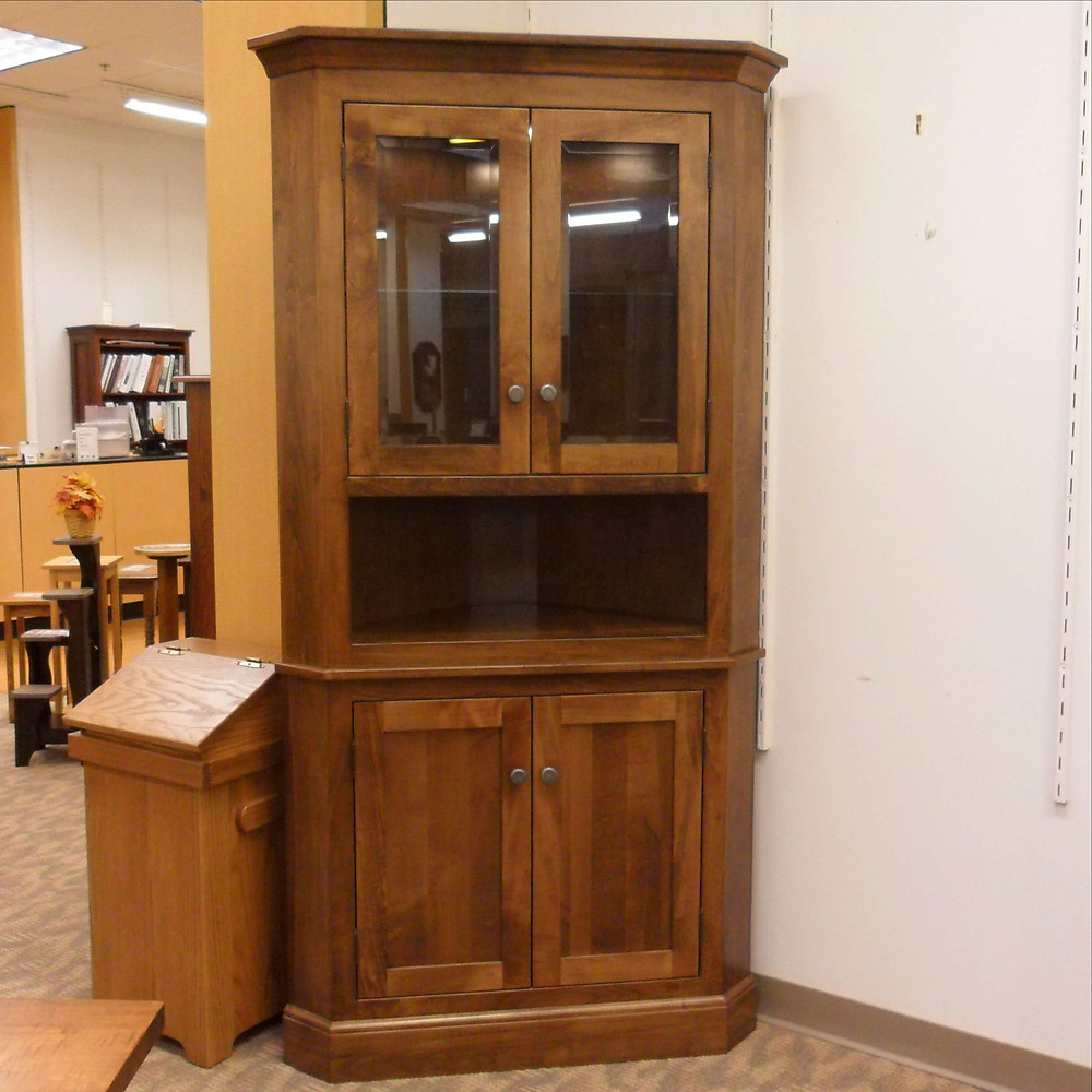 Americana Corner Hutch as displayed at The Amish Home Furniture Gallery at The Galleria at Pittsburgh Mills Solid Maple Corner China Cabinet with shaker panel inset doors and fully enclosed base with pewter hardware built-to-order hardwood furniture made in the USA