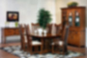 New Classic Mission Amish Dining Room Furniture Collection, with Arts and Crafts trestle table with extension boards. Four craftsman style side chairs and two arm chairs with upholstered seats and walnut inlay. China cabinet with three wood doors with square flat panel, two buffet drawers, four silverware drawers, three glass doors with beveled glass and mullions, adjustable glass shelves with wood face, touch-switch light, walnut inlays. Sideboard with two drawers and two doors. All in quartersawn white oak with black Mission knobs and pulls. Made in the USA Amish Dining Solutions