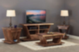 "Junction Living Room Furniture Collection|Modern rustic living room set featuring 1 1/2"" live edge tops set atop V-shaped bases with wide bottom shelf and angled plinth base. TV stand has one drawer and open shelves, coffee table, end table, and mini end table each have one drawer. Brushed oil rubbed bronze handles.