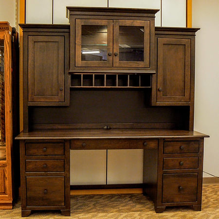 New On Display Cherry Valley 72in Desk Double pedestal desk with four box drawers, two file drawers, keyboard drop-down drawer, and two pull-out writing tablets. Hutch top features two wooden side doors and step-up center with pigeon-holes and a cabinet with glass doors with a light. Solid Rustic Cherry in Cocoa OCS122 72in W x 25in D x 78in H Solid Hardwood Furniture Made in the USA The Amish Home Furniture in Pittsburgh Mills