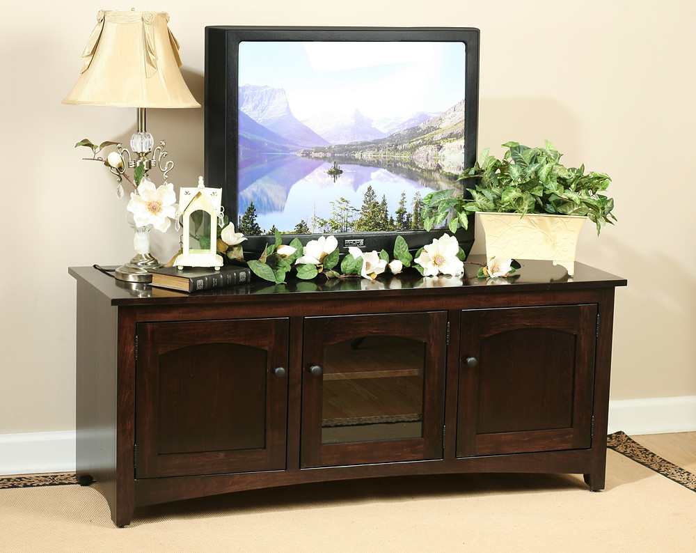The Quaker TV Stand is shown in brown maple