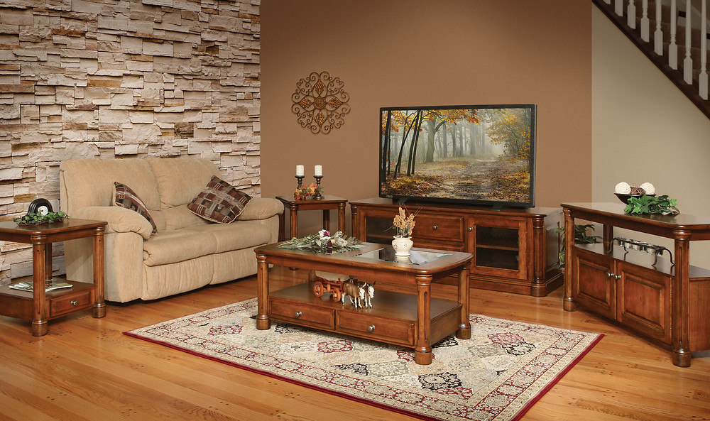 The Adams Low TV Stand is shown in cherry with matching coffee table end table and sofa table
