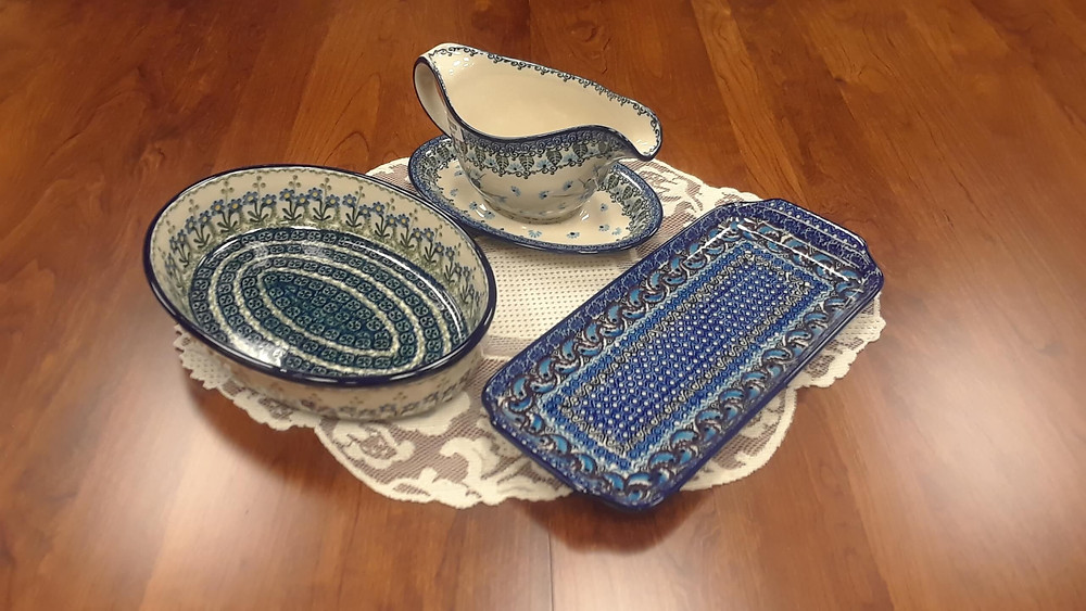"Items Shown:  Gravy Boat with Saucer - Pattern 2275 Medium Oval Baker 10.5"" - Blue Spring Daisy Pattern Short Serving Tray - Purple Paisley (U2) Pattern  Shown on our Leg Table Group B, built in rustic cherry with Michaels stain"