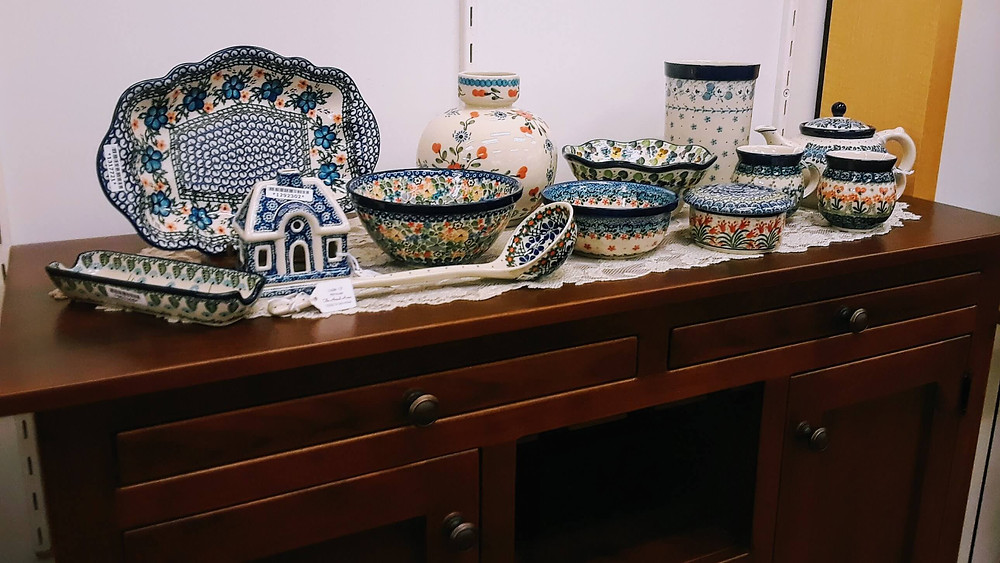 Polish pottery mugs, teapot, serving platter, vase, utensil holder, ladle, jar with lid, house-shaped candle holder, cracker tray
