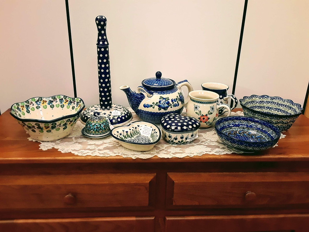 "- Small Bowl with Curvy Edge - Flourishing Petals - Butter Bell 4"" - Green Deco - Unikat (U3) Pattern - Paper Towel Holder - Bleeding Heart - Heart Bowl with Hanging Loop 6"" - Early Spring - Teapot 1.75qt - Blue Poppy - Bubble Mug 16oz - Bleeding Hearts - Bubble Mug 16oz - Cherry Blossoms - Heart Shaped Box 4"" - Bleeding Heart - Soup/Salad Bowl - Purple Paisley - Unikat (U2) Pattern - Fluted Bowl 7.75"" - Crimson Bell - Ceramika Artystyczna Bolesławiec Polish Pottery - The Amish Home - Galleria at Pittsburgh Mills Amish Furniture"