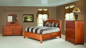 Crescent Amish Bedroom Furniture Collection. Platform bed frame queen with under bed storage drawers and curved headboard with low footboard and curved feet. 7 drawer dresser with flat inset drawers, curved base, arched mirror with jewelry box. Wooden chest of drawers with 6 inset flat drawers and arched base with curved feet. Built in solid cherry wood with brushed nickel knobs and handles. Transitional furniture, contemporary bedroom. Made in the USA.