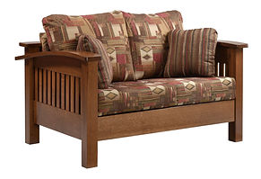 Liberty Mission Loveseat | Shown with fabric upholstery, also available with leather. Craftsman style two cushion loveseat with open slat sides & back, with arched arms. Includes two throw pillows. | Rustic Quartersawn White Oak in Medium OCS110 | 64 1/2in W x 40 1/2in D x 34in H | The Amish Home | Amish Furniture at the Pittsburgh Mills