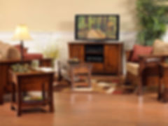 Woodbury Living Room Furniture Collection|Wood-framed sofa with curved legs and arched raised panels, three seats, includes throw pillows, wood-framed chair with curved legs and arched raised panels, three seats, includes throw pillow, coffee table with drawer and shelf, two end tables with drawer and shelf, tv stand with two doors, one drawer, adjustable shelf.|Solid Brown Maple in Asbury OCS117|The Amish Home|Amish Furniture at the Pittsburgh Mills