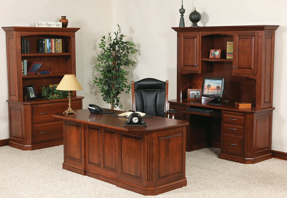 Buckingham Office Furniture Collection shown in solid cherry with washington stain. Executive desk with finished raised panel back, Kneehol desk with keyboard pull out tray with hutch top with two doors and open shelf, two drawer later file with bookcase hutch top. Solid cherry hardwood furniture made in the usa amish furniture pittsburgh mills