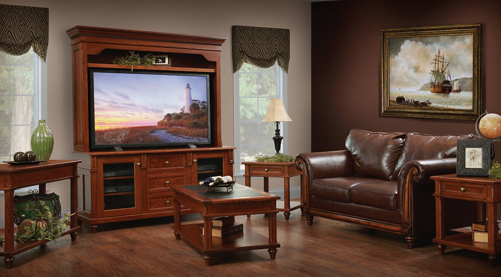 The Fairfield TV Stand with Hutch is shown in quartersawn white oak with matching coffee table end table and sofa table
