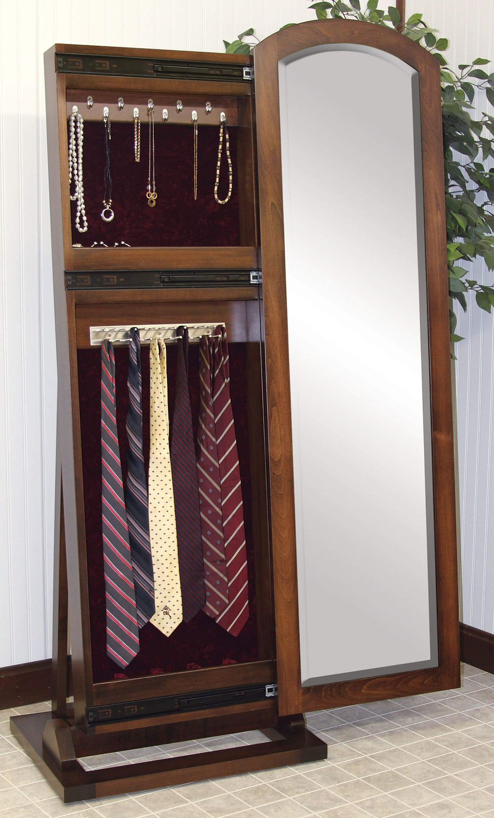 The Antique Shaker Jewelry/Tie Leaner Mirror by Country Corner is shown in brown maple