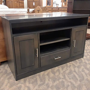 New On Display Nelson's Economy Urban TV Stand Contemporary style TV stand with two doors, one drawer, two open compartments, one with adjustable shelf. Urban is very squared and straight-lined. Nickel hardware. Solid Brown Maple in Antique Slate OCS118 50in W x 18in D x 30in H Solid Hardwood Furniture Made in the USA The Amish Home Furniture in Pittsburgh Mills