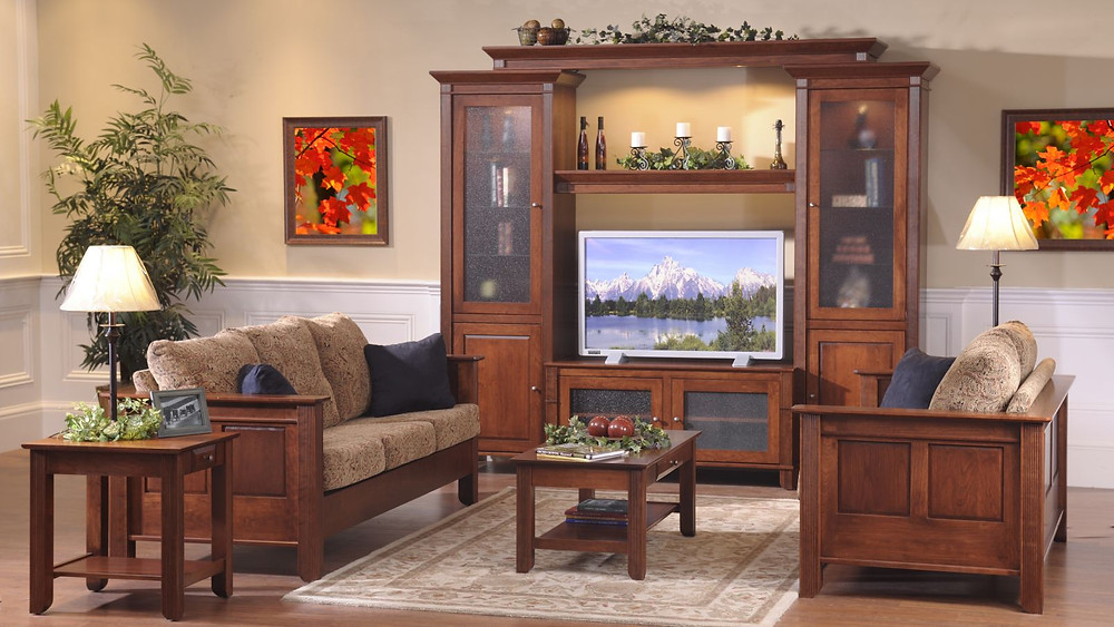 The Springfield Living Room in brown maple includes sofa loveseat entertainment center coffee table and end table