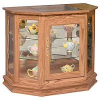 Angled Picture Frame Console Curio | Glass top, 2 adjustable shelves with plate groove, mirror back, clear glass, 2 LED touch lights, brass plate with lock, door hinged right | Oak in MX OCS103 | 35in W x 19 3/4in D x 30in H | The Amish Home | Amish Furniture at the Pittsburgh Mills