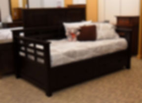 Floor Model Special Addison Day Bed with storage drawers Arts and crafts style daybed with underbed storage drawers. Craftsman style slats on back and sides. Two large storage drawers with stickley mission style hardware. Fits a twin mattress. Solid Brown Maple in Onyx OCS230 83 1/2in W x 46 1/4in D x 37in H Made in the USA Solid Hardwood Furniture Made in the USA The Amish Home Furniture in Pittsburgh Mills