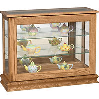 Small Console Curio with Sliding Door | Glass top, 2 adjustable shelves with plate groove, mirror back, clear glass, no light, door slides left | Oak in Medium OCS110 | 38in W x 13 1/4in D x 30in H | The Amish Home | Amish Furniture at the Pittsburgh Mills