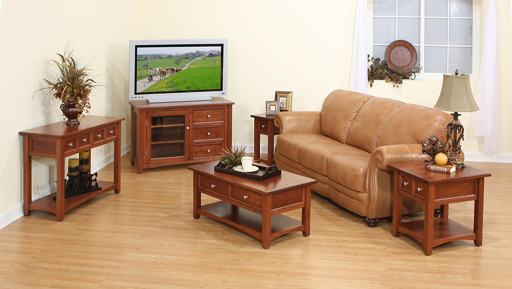 The Ruby Fields TV Stand is shown in brown maple with matching coffee table end table and sofa table